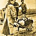 Barefoot French refugee girl with her siblings in a wheel barrow, undated NARA111-SC-50045
