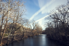 Red Cedar Winter Blues (matthewkaz) Tags: redcedar river redcedarriver water longexposure ndfilter reflection reflections sky clouds trees contrail contrails chemtrail chemtrails msu michiganstateuniversity college campus building hannahadministrationbuilding eastlansing inghamcounty michigan 2019 rapids