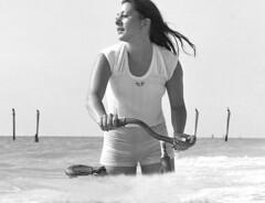 Bicycle pleasure, 1978 (clarkfred33) Tags: wetportrait water wade saltwater ocean surf adventure wetadventure pleasure wetfun beach indianrocksbeach shortshorts wetshorts bicycle wetbicycle vintage vintagephoto 1978 swimwear photoshoot
