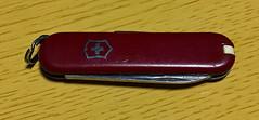 My 1980s-Vintage Swiss Army Knife (sjrankin) Tags: 18march2019 edited closeup pocketknife knife red swissarmyknife scuffed scratched table kitahiroshima hokkaido japan