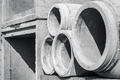 (Laura Sergiampietri) Tags: bn abstract lucieombre urban lightsandshadows bw biancoenero blackwhite shapes concrete industrial squared circles tubes smcpa3570f3545 smcpentaxa3570f3545 shadows naturallight naturalillumination sunlight noon things geometric geometry minimal minimalism