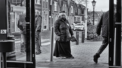 They Don't Even See Me At Christmas Time (Alfred Grupstra) Tags: blackandwhite people urbanscene street citylife city store outdoors editorial men shopping walking sidewalk buildingexterior europe retail monochrome women santa