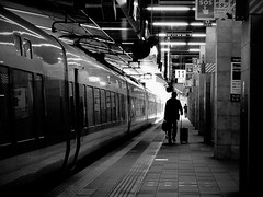 Homecoming Train (明遊快) Tags: station candid monochrome contrast travelpeople lines lights 帰郷 車掌さん サンダーバード silhouette train windows 雷鳥号 特急列車