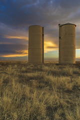 Sister Silos (Tom Herlyck) Tags: america beautiful colorado digital easterncolorado flickr greatamericandesert highplains image jazzed landscape neglected outdoors prairie sunset usa vintage weather silos amazing clouds farm grass