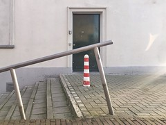 (joostmarkerink) Tags: composition street stairs door bollard