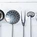 kitchen utensils on white wooden background