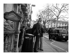 An air of expectancy (exreuterman) Tags: london street olympus m43 micro 43 bloomsbury bw monochrome candid