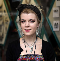 Lexi - stranger 188/200 (englishreader) Tags: 100strangers strangers stranger strangerphotography street streetphotography streetportrait streetportraiture people peoplephotography portrait portraitphotography portraiture headshot thehumanfamily female woman women lady ladies youngwoman younglady girl girls daylight availablelight naturallight 50mmlens primelens canon nottingham headband headscarf smile smiling happy jewellery silver black pattern patterns green earrings nosering window glass shop store