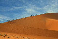 Sossusvlei (brian_stoddart) Tags: travel desert desolate people walking trek sand sky contrast colour africa namibia clouds scale