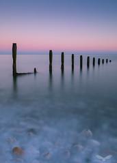 Old groynes - sunrise #3 (Andy Davis Photography) Tags: sunrise groynes coast sea goldenhour glow sky water longexposure leefilters spring morning canon twilight