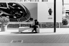 Time (Giorgos Voulgaris) Tags: nikonem analog film kodak tmax400 bw blackwhite candid street streetphotography pisa time clock bench