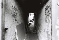 Wood Buildings Passage (goodfella2459) Tags: nikonf4 afnikkor24mmf28dlens cinestillbwxx 35mm blackandwhite film analog london eastend whitechapel whitechapelroad passage maryannnichols jacktheripper history crimehistory bwfp