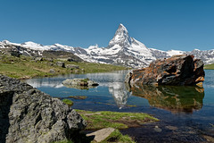 A famous one :-)... (Tjaldur66) Tags: mountains swissmountains swissalps zermatt matterhorn valais lake mountainlake water reflection peak snowypeak outdoor hiking travel rocks