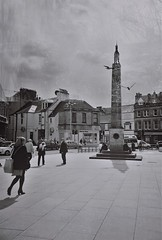Something In the Sky, Inverness, May 2016 (Mano Green) Tags: street people birds city square double exposure multiple monument sky lomo lca ilford xp2 super 35mm film black white may spring 2016 inverness scotland uk