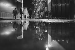 don't look back (Zesk MF) Tags: bw black white mono zesk x100f fuji puddle pfütze street reflection mirroring water night strase people man