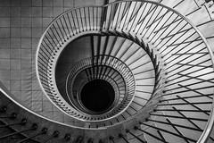 Dark hole (michael_hamburg69) Tags: deutschland treppe stairs stairwell stairway staircase spiral wendeltreppe wendel helix treppenhaustreppenauge escalier geländer handlauf stufen stufe escala escalera scala 台阶 [臺階]táijiē jiētī 阶梯 [階梯]подниматься по лестнице крутая лестница schlosstrasse60 wandsbek hamburg vertigo swirl