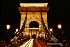 Szechenyi Chain Bridge in the Night Budapest (Vern Krutein) Tags: szechenyichainbridge chainsuspensionbridge danuberiver budapest night exterior outdoors outside nighttime hungary hungarian travel scenics architecture europe european structure historic bridge crossing span carlights streaks lampstandards cehv01p0711
