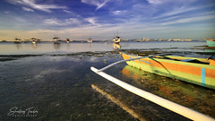 Early Morning Low Tide (engrjpleo) Tags: danaobeach panglao island bohol boat centralvisayas philippines landscape seascape water waterscape seaside sea shore coast outdoor cloud sky sunrise longexposure beach
