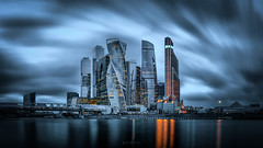 Passing by... (alvytsk) Tags: moscow city cityscape longexposure ndfilters moscowcity evening clouds sunset skyscrapers building water river russia