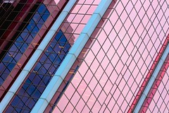 Pink Glass (Karen_Chappell) Tags: glass pink pastel blue windows angle geometry geometric rectangle architecture city urban stjohns newfoundland nfld canada atlanticcanada avalonpeninsula reflection tilt lines abstract square building