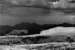 Distant Rain (chrislon28) Tags: yellowstone yellowstonenationalpark nationalpark blackandwhite film canonfilm ftb fd 35mm landscape wyoming kodak plusx iso125 rain plain clouds