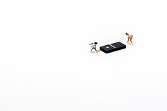 Mind Games (abnormally average) Tags: preiser littlepeople smallworld miniatureart art minimalist minimal railwayfigures model toys domino tennis sport lilliput souppickle spickle abnormallyaverage little tiny idea humour sort white