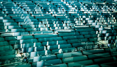 reality, thinly sliced (Reflectory (Chris Brown)) Tags: abstract abstraction people horizontal landscape green blue turquoise white black lines sunlight shadows reflection reflections strips diagonals geometry pillars windows glass louvers facade reflectory