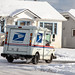 Everett WA. / USA - 02/09/2019: US Postal Service Jeep Delivering Mail During Unusual Winter Snow Storm