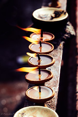 Nepal_S1 (Paterdimakis) Tags: nepal religion candle colour color flame fire light fuji travel culture