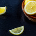 Fresh ripe lemons on black background