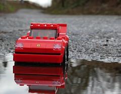 Ferrari F40 on the Road (captain_joe) Tags: toy spielzeug 365toyproject lego minifigure minifig car auto 6wide speedchampions ferrari f40 road strase puddle