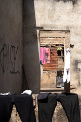 into the closed (k-os) Tags: ghana wrack africa window laundery ruin door clothes dry accra