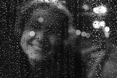 Look through (Explored on 18.01.2019) (c.bartsch) Tags: fujifilm fuji xt3 xf27mm black white monochrome bw raindrops nightshot smiling window sooc acros acrosfilmsimulation