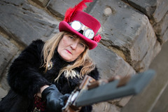 Battling Steampunk at the Whitby Steampunk Weekend V - Ohh La La (Gordon.A) Tags: yorkshire whitby steampunk whitbysteampunkweekend v wsw february 2019 convivial festival event eventphotography culture subculture lifestyle creative costume hat goggles people lady woman model pose posed posing wall outdoor outdoors outside day daylight naturallight colour colours color amateur street portrait portraitphotography digital canon eos 750d sigma sigma50100mmf18dc