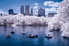 Boating (Adventures in Infrared) (Torsten Reimer) Tags: usa manhattan northamerica see water newyork centralpark lake gebäude clouds bäume trees unitedstatesofamerica himmel infrared buildings nyc newyorkcity people sky park wasser infrarot olympusepl5 boats unitedstates us
