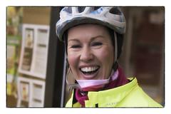Now that's a smile (Frank Fullard) Tags: frankfullard fullard candid street portrait smile cyclist pinkribbon bickcle castllebar mayo irish ireland happy radiatingyellow red pink cancer research