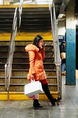 Been out Shopping - Times Square Subway Station, NYC (TravelsWithDan) Tags: subway 42ndstreet station stairway night woman pinkcoat shoppingbags nyc newyork candid street streetportrait canong9x city urban phone reading glasses