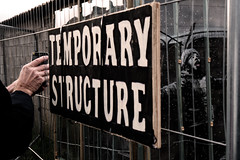 Temporary Structure with Hand (stevedexteruk) Tags: banksy art street porttalbot wales temporary structure sign fence snow boy child pollution mobile phone hand 2019 graffiti