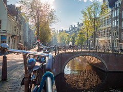 Autumn in Amsterdam (TeunJanssen) Tags: bicycle amsterdam sun canal canalhouses city capital dof autumn fall fiets trees olympus omd omdem10 travel traveling worldtravel