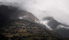 Upper Pisang (MANUELup) Tags: nepal upperpisang pisang mist fog mountain cloud temple buddhism trees forest snow meadow green white orange yellow himalaya landscape naturallight rock rockymountains