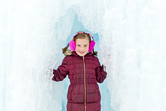 Pretty Girl in Ice Castles Cave (aaronrhawkins) Tags: ice castles girl child pose portrait cold winter freeze frozen rosy cheeks coat warm red blue colorful children cave tunnel icicle clear midway utah clara aaronhawkins