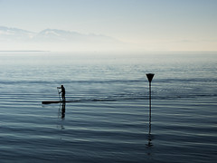 SUPing around (Ulmi81) Tags: sup suping stand up paddeling traffic sign water lake constance bodensee lindau bavaria apls seascape landscape wave waves calm silhouette backlight day active sport sports activity pole