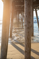 Pier and Sunshine (Photos By Clark) Tags: subjects canon2470 canon5div beachshots sandiegogeneral imperialbeach california unitedstates us lightroom thesandiegoist pacific light shadows pier wood post water waves surf sand