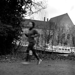 Runner (ucn) Tags: rolleiflex35b mutar07x agfacopexrapid charlottenburg street filmdev:recipe=12019 adoxadoluxatm49 developer:brand=adox developer:name=adoxadoluxatm49