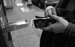 quarters (blakeboulka) Tags: 35mm blackandwhite ilford delta100 film bw delta bnw walking exploring chinatown coin purse machine chanel hands quarters sanfrancisco grainy manual analog nikon f3