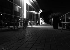 The Patio (that_damn_duck) Tags: nikon blackwhite patio chairs bench walkway brickwork bw blackandwhite night nighttime