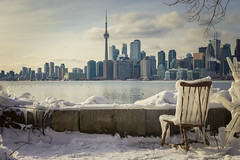 A Beautiful Winter Day In Toronto (A Great Capture) Tags: winter toronto ontario canada photographer canadian northamerica on agc 2019 ald jamesmitchell ash2276 adjm l'hiver ashleylduffus torontoexplore wwwagreatcapturecom agreatcapture mobilejay frozen icw icy city urban skyline chair cntower seat lights downtown snow cold weather light sun sunlight sunshine gold golden sunny digital canon lens eos dslr mark ii 6d ef2470mm urbannature outside outdoors outdoor wet water agua eau waterscape branch branches schnee neige clouds cloudy empty