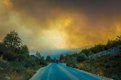 Andrew cycling along the Carretera Austral amongst some forest fires outside Cochrane.