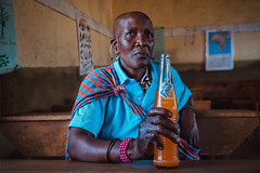Fanta (u c c r o w) Tags: orange blue fanta colors colorful woman maasai africa african portrait portre urban urbanlife arusha tanzania indoor room