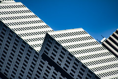 (jfre81) Tags: houston downtown architecture building abstract minimalist facade continental airlines tower blue sky geometry diagonal lines htown htx james fremont photography jfre81 canon rebel xs eos